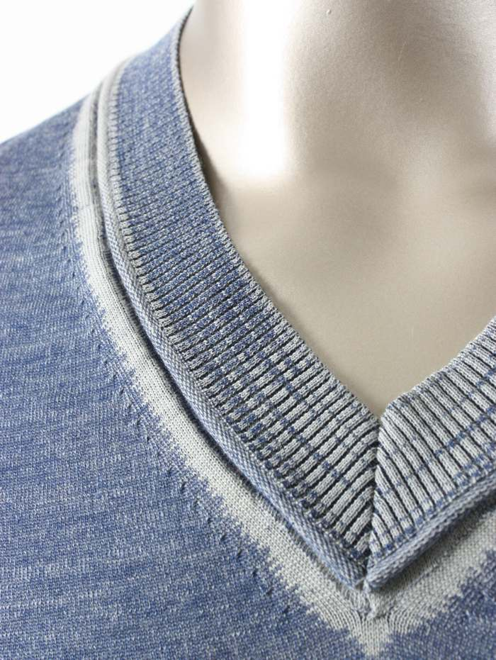 This Stoll sample shows a pullover with French shoulder in plated jersey with inverse plated edges and V-neck and seams with on the rear knitted curled edges.